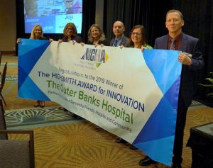 team from Outer Banks hospital holding banner that says Highsmith Award for Innovation.